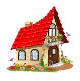 有一个阳台的童话房子有花的 免版税库存图片