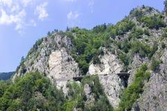 有一个隧道的山路在罗马尼亚 库存图片