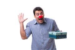 有一件红色鼻子滑稽的藏品的人购物袋礼物礼物是 免版税图库摄影