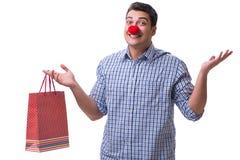 有一件红色鼻子滑稽的藏品的人购物袋礼物礼物是 图库摄影