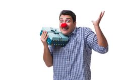 有一件红色鼻子滑稽的藏品的人购物袋礼物礼物是 免版税库存图片