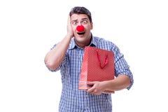 有一件红色鼻子滑稽的藏品的人购物袋礼物礼物是 库存图片