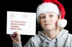有一份信函的子项圣诞老人的 免版税库存图片