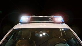 有一刹那光和警报器的警车 库存照片