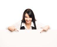 有一副大白色横幅的一名年轻女实业家 库存图片