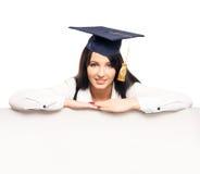 有一副白色横幅的一名梯度学生 免版税图库摄影