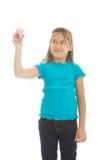 有一只大蜡笔的小女孩 图库摄影