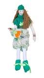 有一只鸟的手工制造玩偶在礼服的手上和毛线衣坐 免版税图库摄影