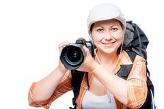 有一台大照相机的快乐的人摄影师在白色 免版税库存图片