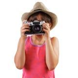 有一台影片照相机的女孩在手上  库存照片