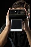 有一台快速照相机的摄影师 免版税库存图片