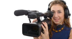 有一台摄象机的少妇,在白色背景 免版税图库摄影