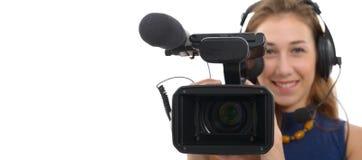 有一台摄象机的少妇,在白色背景 库存照片