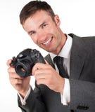 有一台数字照相机的人 库存照片
