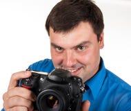 有一台数字照相机的人 免版税图库摄影