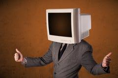 有一台显示器的商人在他的头和棕色空的空间 库存图片