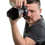 有一台照相机的画象摄影师在被隔绝的背景 库存图片
