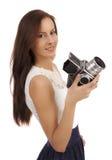 有一台老照相机的女孩 库存图片