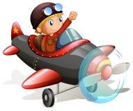 有一名年轻飞行员的葡萄酒飞机 免版税库存图片