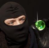 有一块大绿宝石的窃贼 免版税库存图片