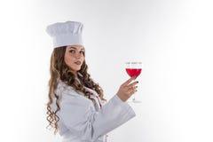 有一块大玻璃的女孩厨师 库存图片