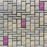 有一块灰色和紫色砖的,纹理墙壁 图库摄影