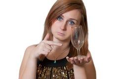 有一块空的玻璃的妇女 库存照片