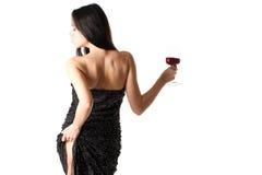 有一块红葡萄酒玻璃的夫人 免版税库存照片