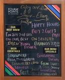 有一家餐馆的奉献物的黑板在四点中希拉顿阿格拉 免版税库存图片