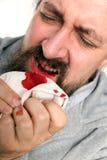 有一张血淋淋的嘴的人 库存图片