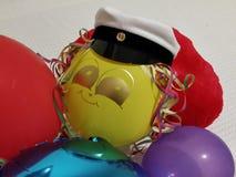 有一张兴高采烈的面孔的党气球 免版税图库摄影