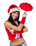 有一把伞的圣诞老人女孩反对白色 库存图片
