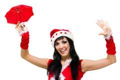 有一把伞的圣诞老人女孩反对被隔绝的白色 库存图片