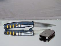 有一把刀片的铅笔刀从锦缎钢 免版税图库摄影