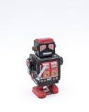 有一把剑的葡萄酒黑机器人玩具在白色背景 库存图片