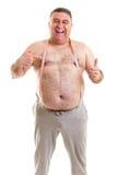 有一把卷尺的愉快的肥胖人在他的脖子上 免版税库存照片