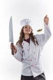有一把大刀子的女孩厨师 库存图片
