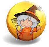 有一把笤帚的巫婆在黄色徽章 免版税库存照片