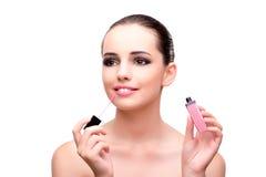 有一支唇膏的妇女在白色 免版税库存照片