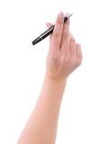 有一支笔的女性手署名的 免版税库存照片