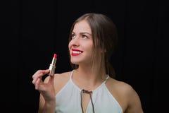 有一支红色唇膏的妇女 免版税图库摄影