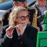 有一支长笛的音乐家在一个自由音乐会 库存照片