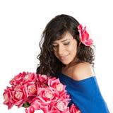 有一朵玫瑰的妇女在她的头发 免版税库存图片