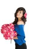 有一朵玫瑰的妇女在她的头发 库存照片