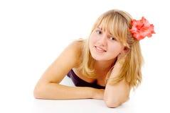 有一朵美丽的花的女孩 库存照片