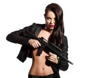 有一杆枪的妇女在现有量 免版税图库摄影
