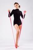 有一条体操丝带的美丽的运动的妇女 库存图片