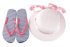 有一条桃红色丝带的帽子和在蓝色和白色条纹的触发器 查出 库存图片