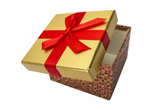 有一条红色丝带的一个开放礼物盒 查出 库存照片