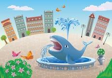 有一条鲸鱼的一个喷泉在镇中心 库存照片